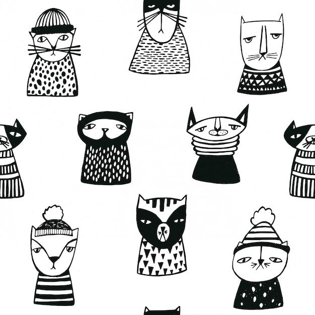 Naadloos patroon met de grappige snuiten van beeldverhaalkatten. hand getrokken doodle kitty karakters. Premium Vector
