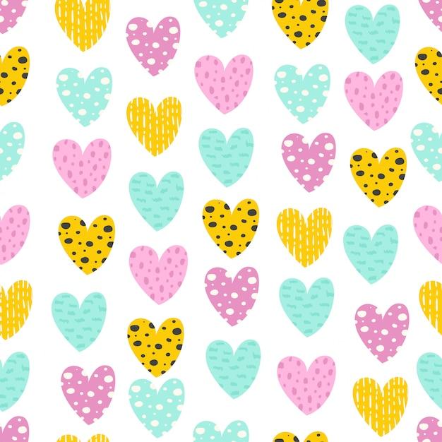 Naadloos patroon met kleurrijke harten Premium Vector