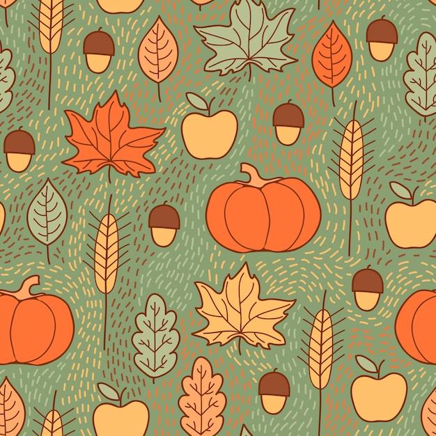 Naadloos patroon met pompoenen, bladeren, tarwe en appels Premium Vector