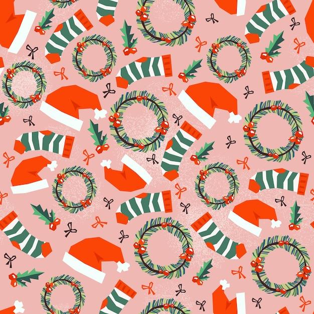 Naadloos patroon met vrolijk kerstpictogram. Gratis Vector