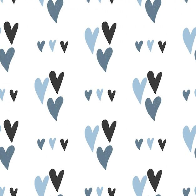 Naadloos patroon van hand getrokken eenvoudige harten in pastel blauwe kleuren Premium Vector