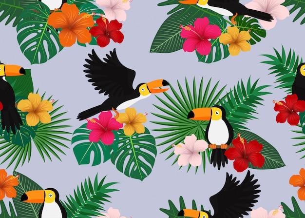Naadloos patroon van tropische bloemen met bladeren en toekanvogel Premium Vector