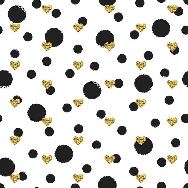 Naadloze inkt polka dot patroon met gouden hart Premium Vector
