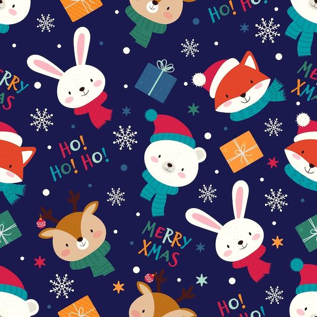 Naadloze kerst patroon met schattige dieren Premium Vector