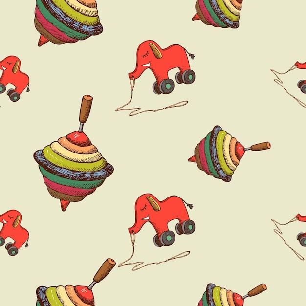 Naadloze patroon babyspeelgoed zweefmolen en olifant Gratis Vector