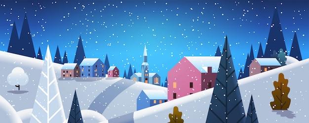 Nacht winter dorp huizen bergen heuvels landschap sneeuwval Premium Vector