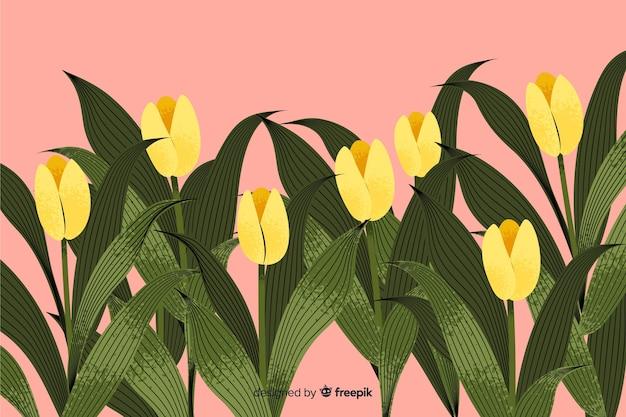 Natuurlijke achtergrond met hand getrokken bloemen Gratis Vector