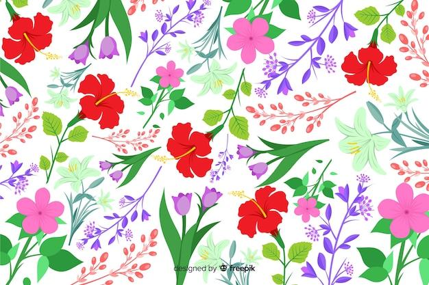 Natuurlijke achtergrond met kleurrijke bloemen Gratis Vector