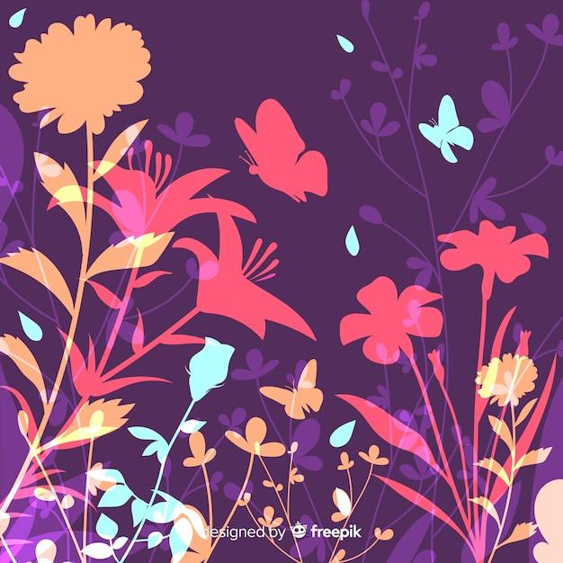 Natuurlijke achtergrond met kleurrijke bloemensilhouetten Gratis Vector