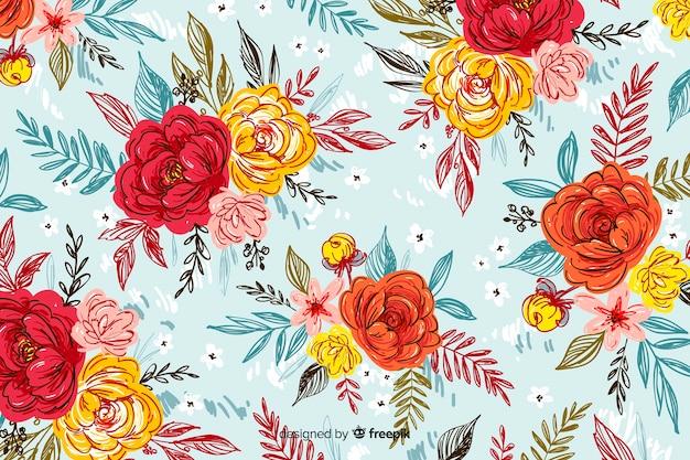 Natuurlijke achtergrond met kleurrijke geschilderde bloemen Gratis Vector