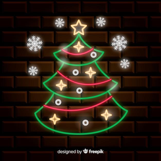 Neon kerstboom achtergrond Gratis Vector