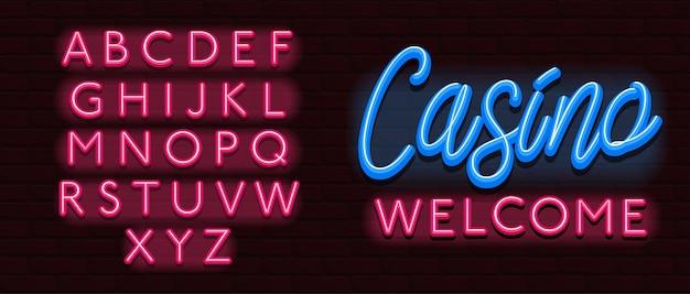Neon lettertype alfabet lettertype bakstenen muur casino Premium Vector