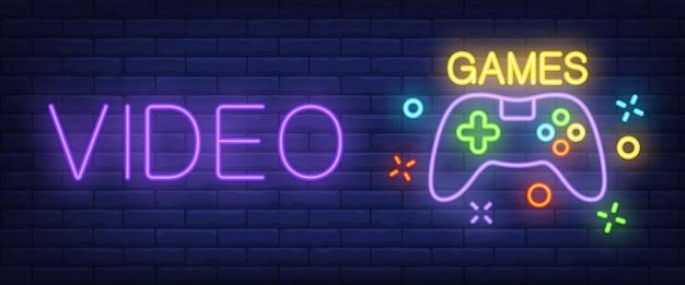 Neon-tekst videogames met controller Gratis Vector