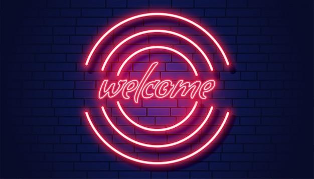 Neon welkom uithangbord op bakstenen muurachtergrond Gratis Vector