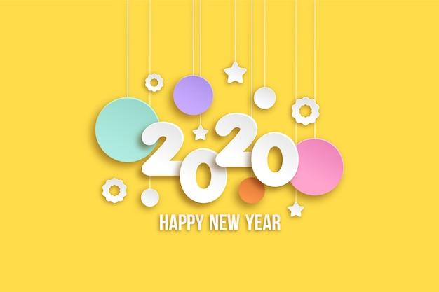 Nieuw jaar 2020 behang in papierstijl Gratis Vector