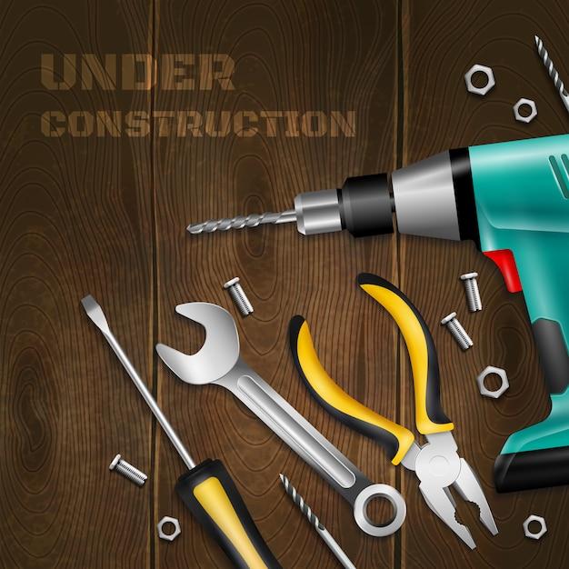Onder constructie houten met verstrooid handvat instrument voor constructie en reparatie werkt realistisch Gratis Vector