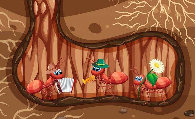 Ondergrondse scène met mieren die muziek spelen Gratis Vector