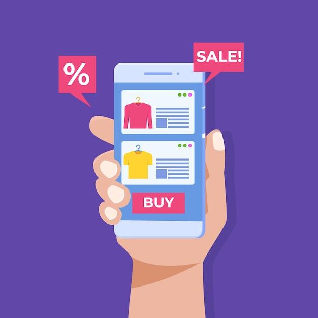 Online kleding kopen, hand met smartphone, digitale marketing. Premium Vector