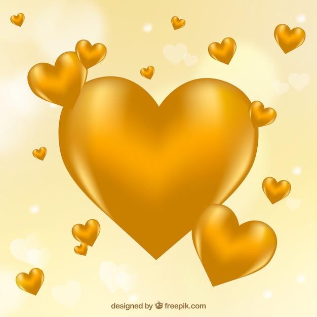 Onscherpe achtergrond van gouden harten Gratis Vector