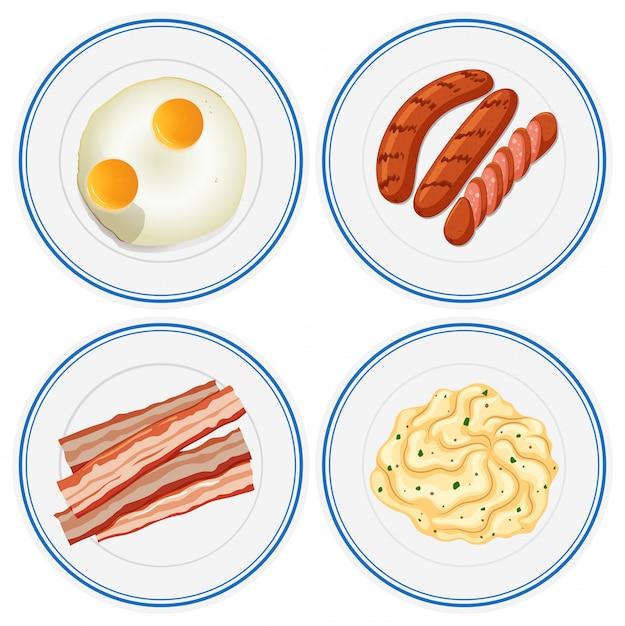 Ontbijt op vier borden Gratis Vector