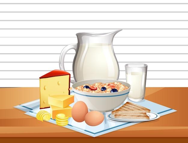 Ontbijtgranen in kom met kruik melk in een groep op tafel Gratis Vector
