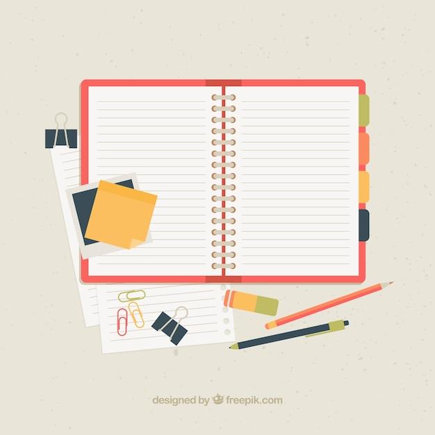 Open notitieboekje met toebehoren Gratis Vector