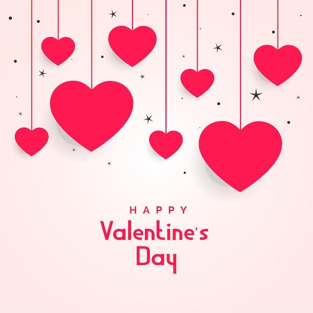 Opknoping harten met sterren voor valentijnsdag Gratis Vector