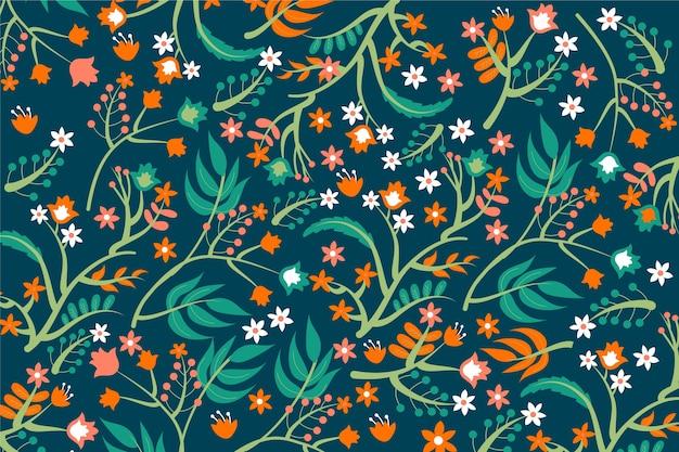 Oranje bloemen met groene gebladerteachtergrond Gratis Vector