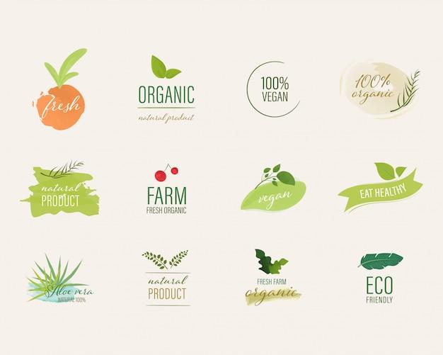 Organische label en natuurlijke label water kleur penseel stijl. Premium Vector