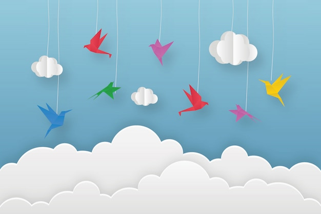 Origami kleurrijke vogels in wolken Premium Vector