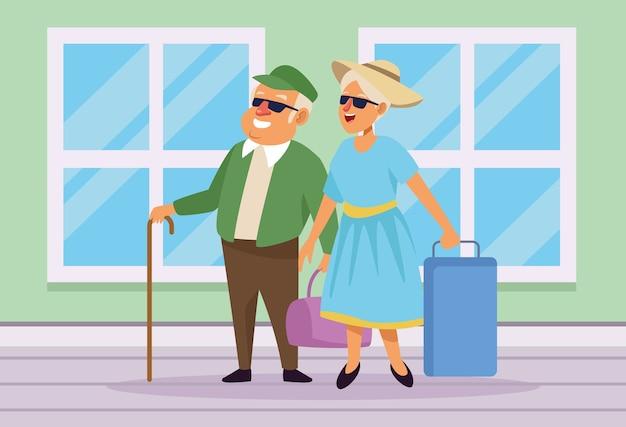 Oud stel met koffers in het huis actieve seniorenkarakters. Premium Vector