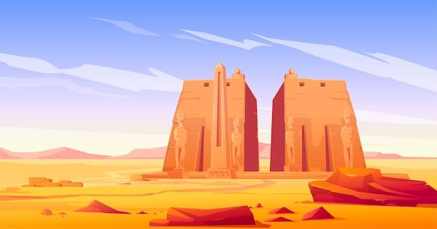 Oude egyptische tempel met standbeeld en obelisk Gratis Vector
