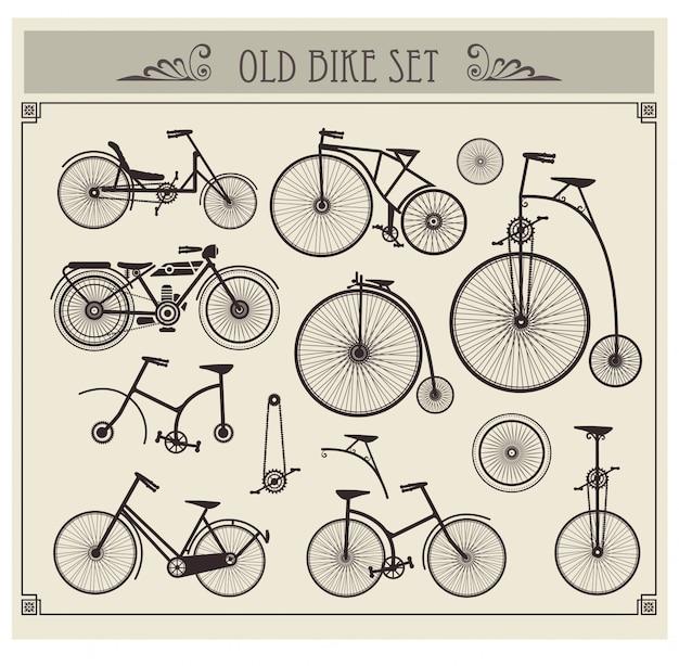 Oude fietsen ingesteld Premium Vector