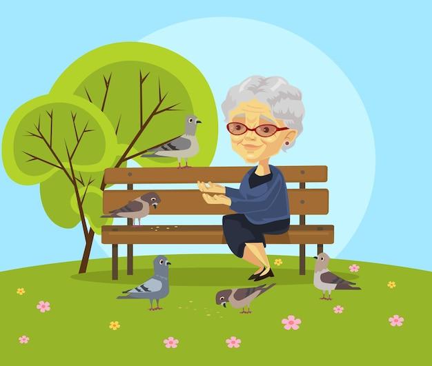 Oude vrouw voederen vogels vlakke afbeelding Premium Vector