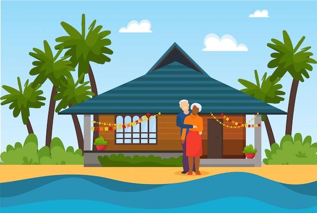 Paar bejaarde hogere mensen op strand dichtbij zeewaterillustratie. mooi ingericht huis in. reis voor rust of viert huwelijksverjaardag. Premium Vector