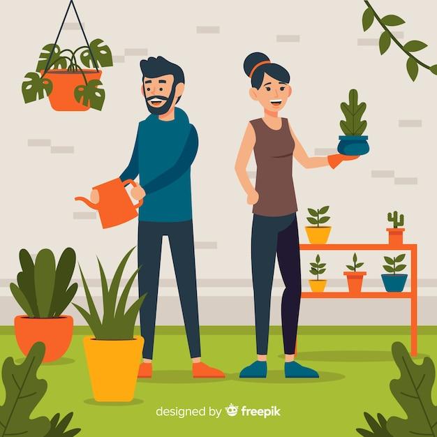 Paar het verzorgen van planten Gratis Vector