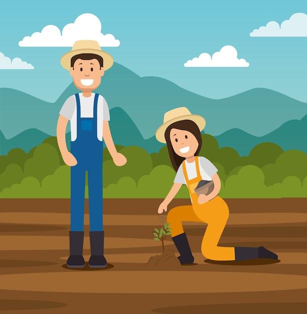 Paar jonge tuinlieden die het tuinieren werken Premium Vector