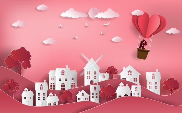 Paar met hete luchtballon die over stad vliegt. Premium Vector