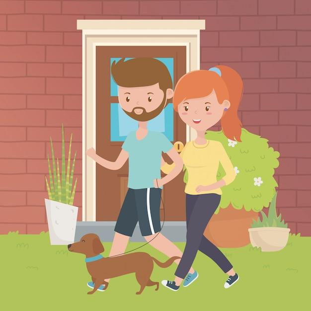 Paar van jongen en meisje met hondontwerp Gratis Vector