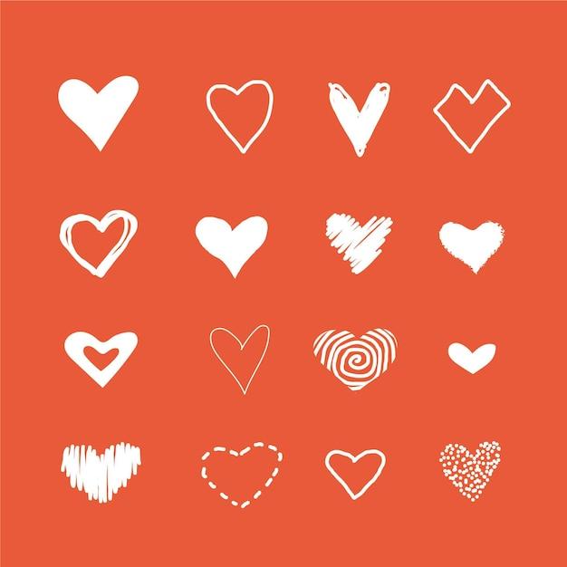 Pak handgetekende hartillustraties Gratis Vector