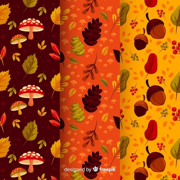 Pak platte herfstpatronen Gratis Vector