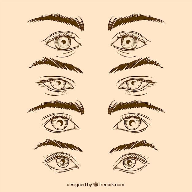 Pak van de hand getekende ogen en wenkbrauwen in realistische stijl Gratis Vector