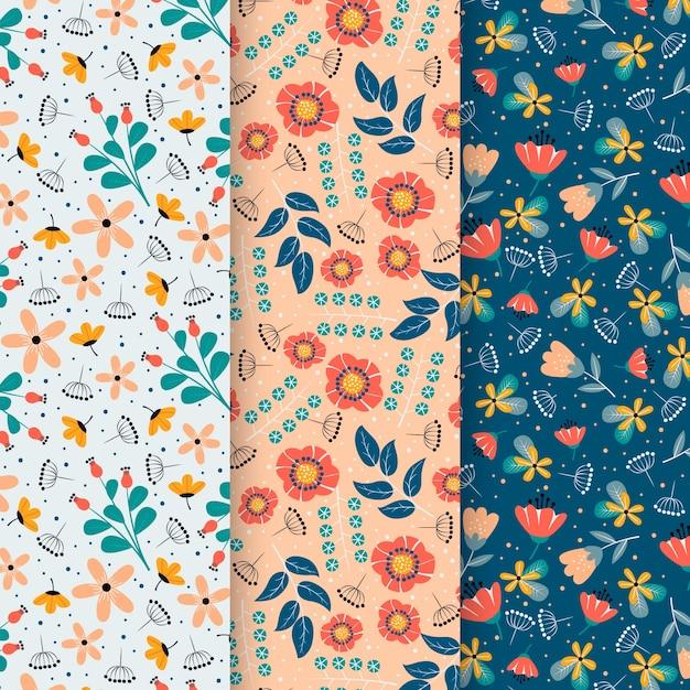 Pak van platte kleurrijke lente patronen Gratis Vector