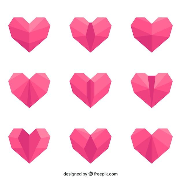 Pak van roze origami harten in plat design Gratis Vector