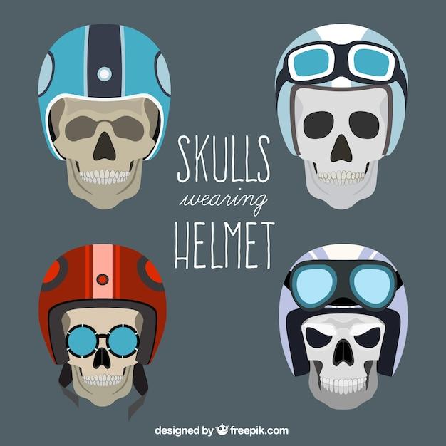 Pak van schedels met helm driver Gratis Vector