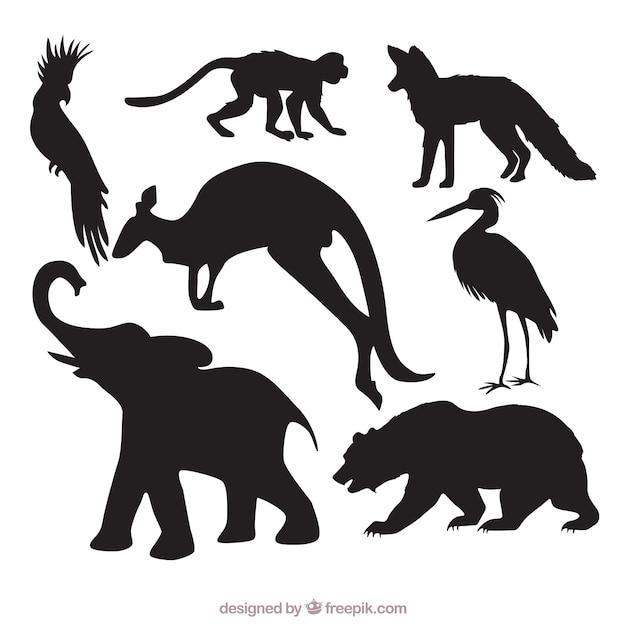 Pak van wilde dieren silhouetten Gratis Vector