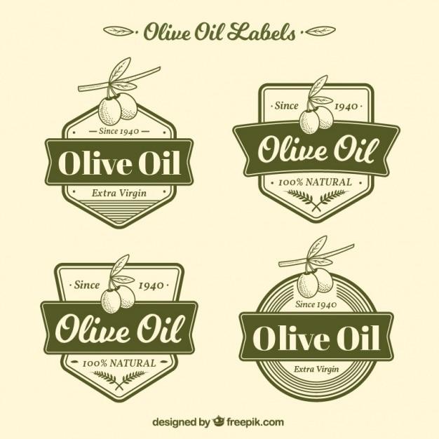Pakje van vier groene olijfolie labels Premium Vector