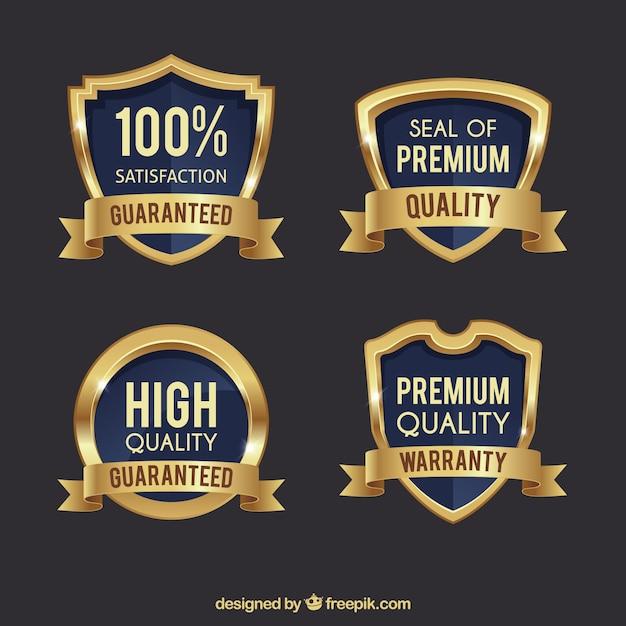 Pakje van vier premium gouden schilden Gratis Vector