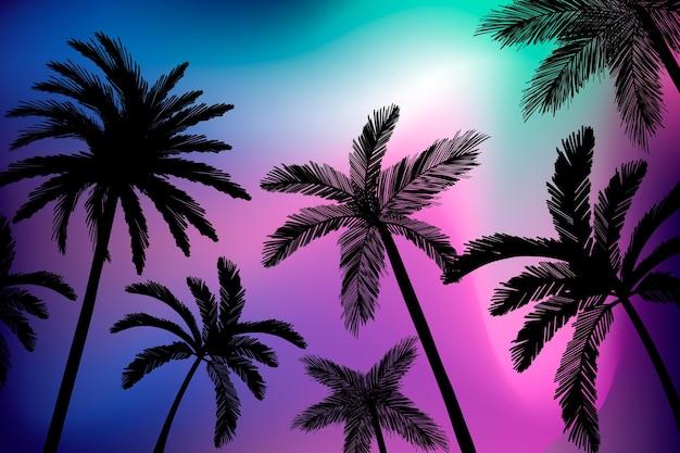 Palmen silhouetten achtergrond Gratis Vector