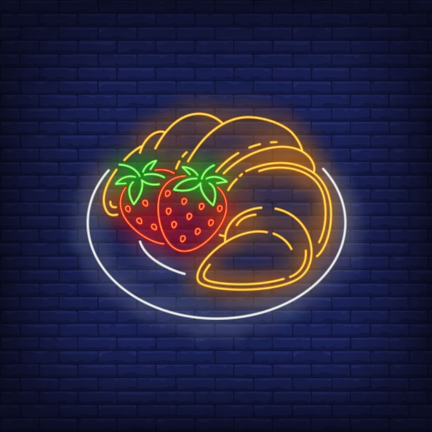 Pannenkoeken met aardbeien neon bord. Gratis Vector